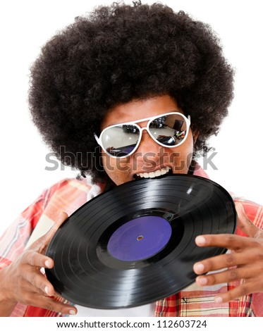Disco man with an afro having fun - isolated over white background