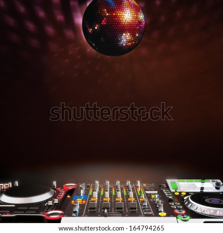 Disco music stage advertisement background with DJ equipment and disco ball red tinted themed background. Room for text or copy space.Disco ball is centered. Off centered also available. - stock photo