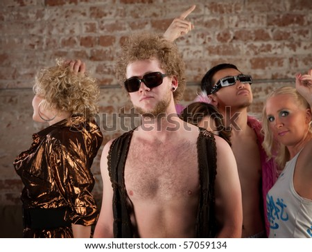 Disco pose with friends at a 1970s Disco Music Party - stock photo