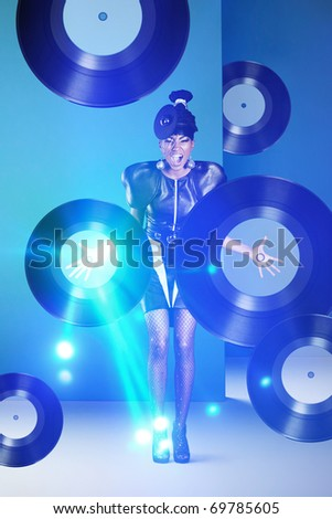 Disco woman screaming with vinyl records in hands and neon light - stock photo