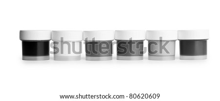 discolored gouache palette jars in a row isolated on white background
