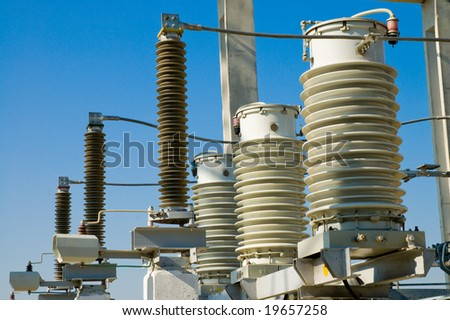 disconnecting switch on high-voltage substation - stock photo