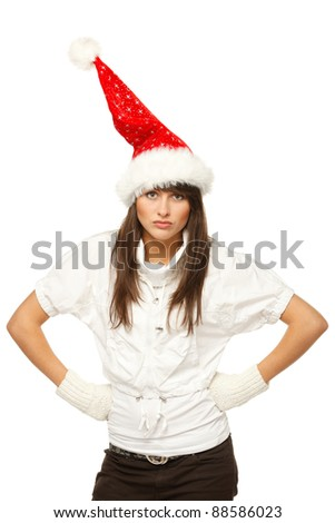 Discontent Santa girl with hands on her waist, isolated on white background - stock photo