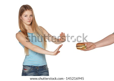 Discontent young female refusing fast food, against white background - stock photo