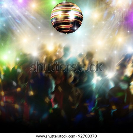 Discotheque with disco ball and people - stock photo