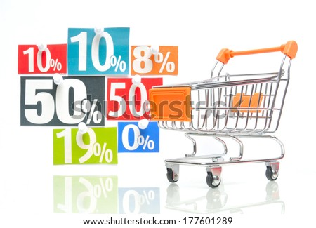 Discount - orange colored shopping cart with multicolored percent newspaper adverts - stock photo