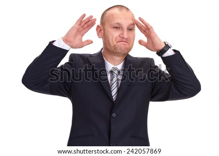 Discouraged, unshaved businessman in a dark suit, raising his hands in disbelief at his bad fortune, isolated on white - stock photo
