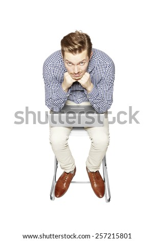 Discouraged young man Young man leaning over the keyboard. - stock photo