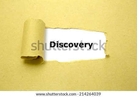 Discovery text appearing behind torn brown paper - stock photo