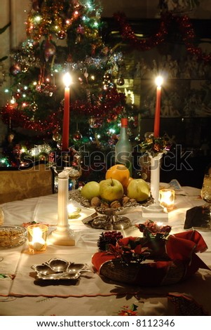 Discreetly candle lit table after Christmas Eve