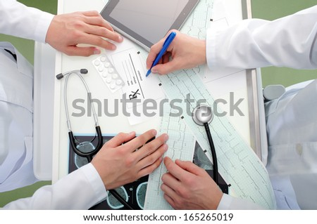 discussion about prescription between doctors  - stock photo