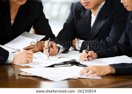 Discussion between businesspeople in office - stock photo