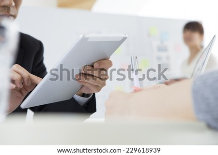Discussion in the office - stock photo