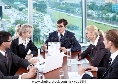 Discussion of important issues in the office - stock photo