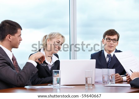 Discussion of working moments in the office - stock photo
