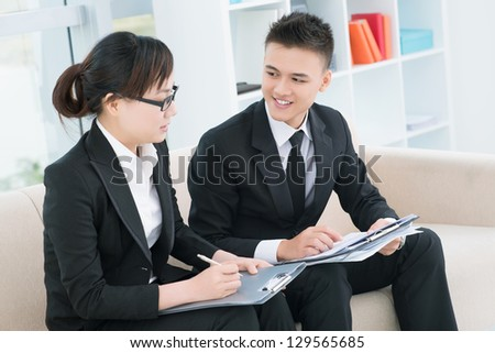 Discussion process of businesspeople at office - stock photo