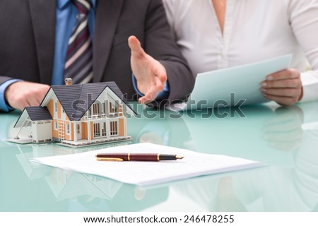 Discussion with a real estate agent at the office - stock photo