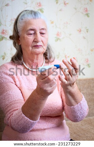 Disease diabetes. Woman testing for high blood sugar. Woman holding device for measuring blood sugar