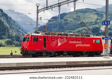 DISENTIS-MUSTER, SWITZERLAND - AUGUST 10: Locomotive of the train at the station in Disentis - Muster, Switzerland on August 10, 2014. - stock photo