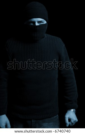 Disguised attacker waiting for a victim - stock photo