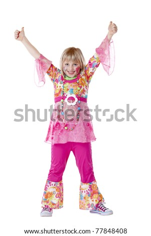 Disguised young girl smiles and holds thumbs up. Isolated on white background. - stock photo