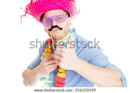 Disguised young man showing thumb up - photo booth photo - stock photo