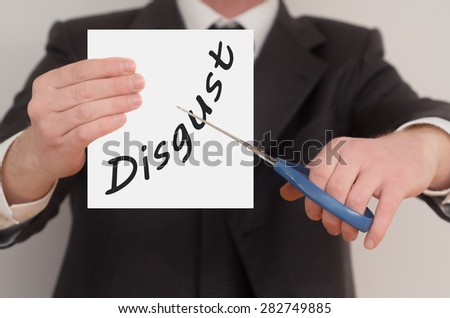 Disgust, man in suit cutting text on paper with scissors