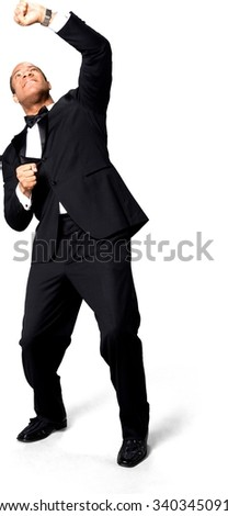 Disgusted African man with short black hair in evening outfit holding invisible object - Isolated