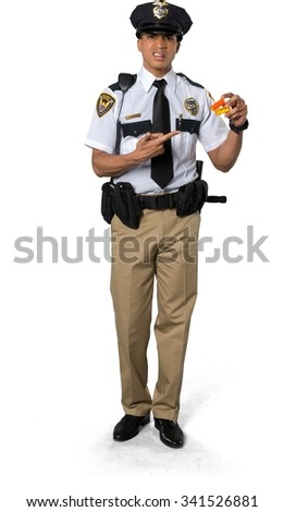 Disgusted African young man with short black hair in uniform holding pill bottle - Isolated - stock photo