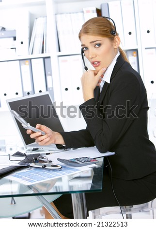 Disgusted Business woman working in office, wearing headset