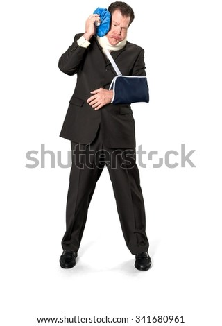 Disgusted Caucasian elderly man with short medium brown hair in business formal outfit using ice bag - therapy - Isolated - stock photo
