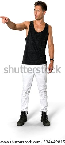 Disgusted Caucasian young man with short medium brown hair in casual outfit pointing using finger - Isolated - stock photo