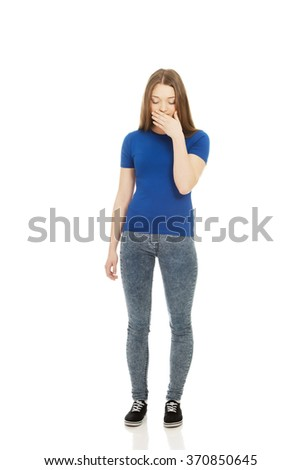 Disgusted teen covering her mouth. - stock photo