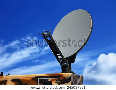 Dish antenna of the military mobile device satellite communication with a metallic reflex reflector in operation - stock photo