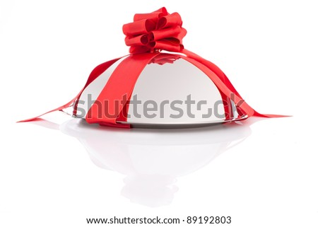 Dish dome with red ribbon as a gift isolated on white background - stock photo