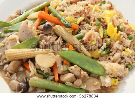 dish full of chinese stir-fry and ham fried rice - stock photo