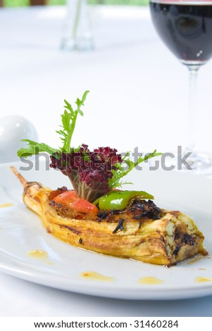 dish made of eggplant stuffed with ground meat. - stock photo