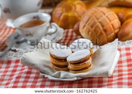 Dish of alfajor dessert at the tea time. - stock photo