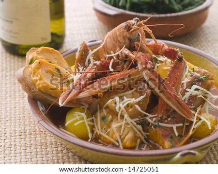 Dish of Bouillabaisse with Rouille Croutes and Gruyere Cheese - stock photo