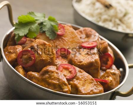 Dish of Chicken Chili Tikka Masala with Fragrant Basmati Rice - stock photo