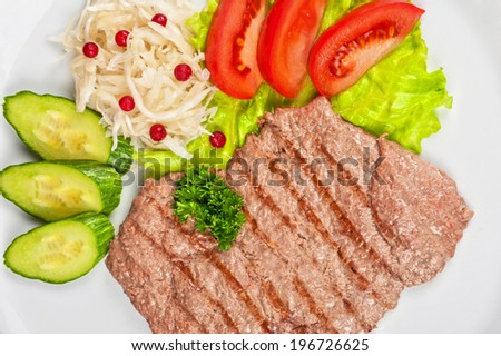 dish of meat chop with vegetable - stock photo