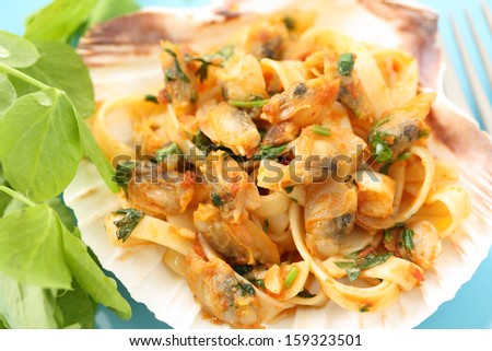 """dish of portuguese clams """"conquilhas"""" with pasta and tomato sauce - stock photo"""