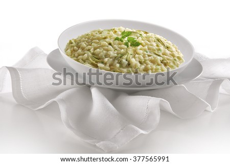 Dish of risotto with artichokes on napkin - stock photo