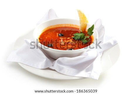 Dish of Stewed Meat Soup with Olives and Lemon - stock photo