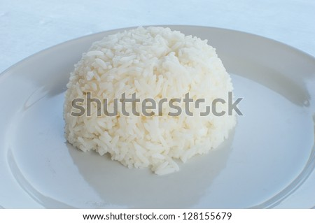 Dish of thai food ; plane steamed rice.