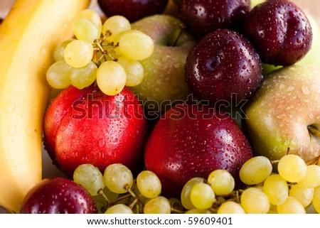 Dish of various fruit - stock photo