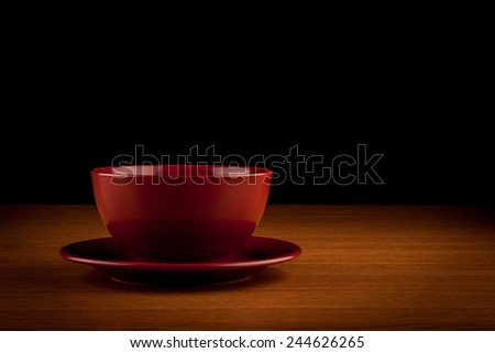 dish on brown table with black background