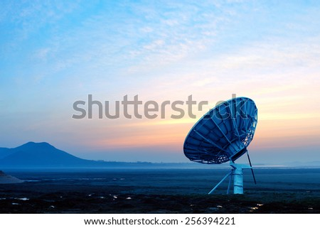 Dish on the prairie, early morning sunrise landscape. - stock photo
