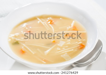 Dish soup with noodles and diced vegetables - stock photo
