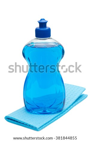 Dish-washing detergent with cloth over white background